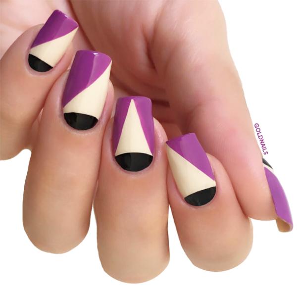 עיצוב ציפורניים גיאומטריות בגווני ניוד, שחור וסגול עם מדבקות גולדניילס לפרנץ' מושלם