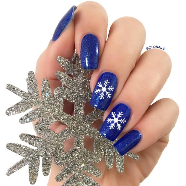 ציפורניים לחורף עם פתיתי שלג על הציפורניים בעזרת שבלונות גולדניילס