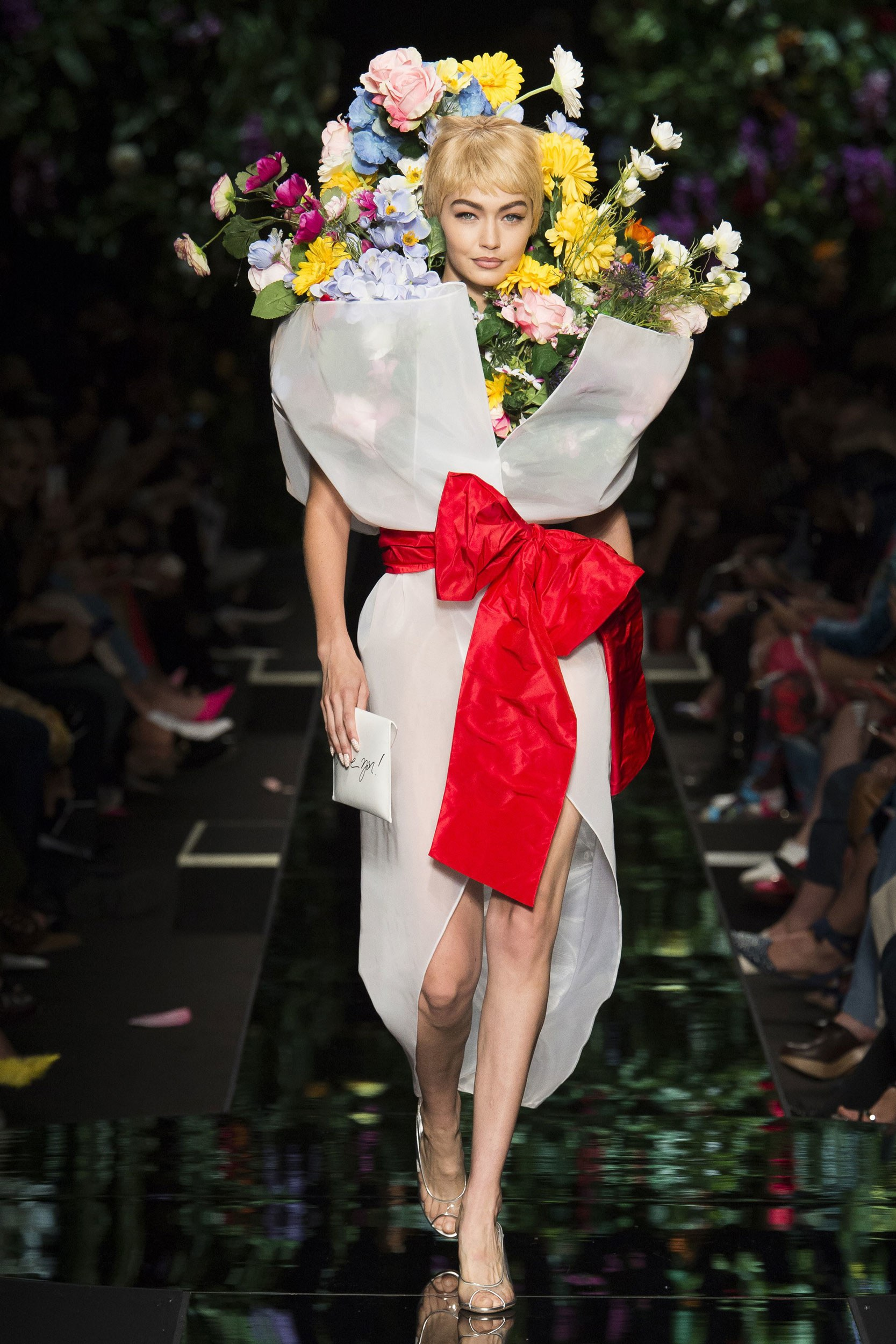 Gigi Hadid as a bodega bouquet at Moschino Spring 2018